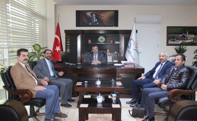 MHP'den Milli Eğitim Müdürüne hayırlı olsun ziyareti