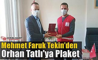 Mehmet Faruk Tekin'den Orhan Tatlı'ya Plaket
